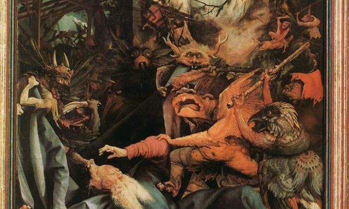 """Anthony is besieged by demons attacking him with sticks on the composition's right and, on the left, others pulls at his cloak and hair, in a detail from """"The Temptation of St. Anthony"""" by Mathias Grünewald. (Public Domain)"""