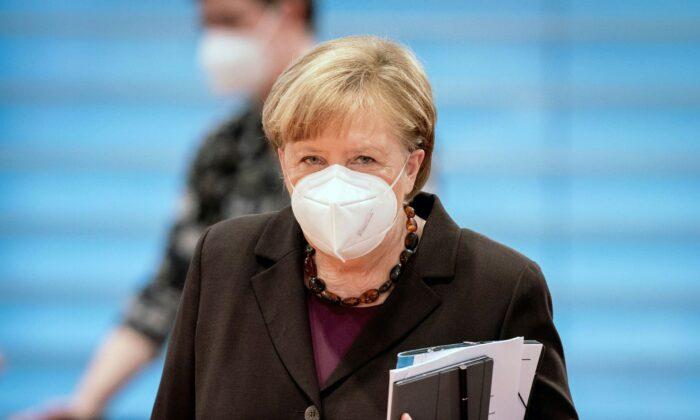 German Chancellor Angela Merkel arrives for the weekly cabinet meeting at the Chancellery in Berlin, Germany, on Feb. 24, 2021. (Kay Nietfeld/dpa via AP, Pool)