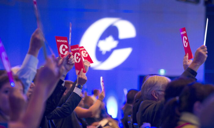 Delegates vote on party constitution items at the Conservative Party of Canada national policy convention in Halifax on Friday, Aug. 24, 2018. (The Canadian Press/Andrew Vaughan)