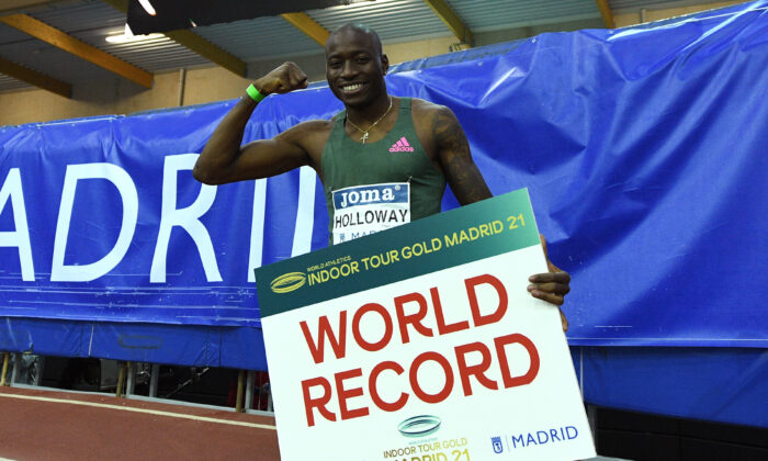 Grant Holloway of the United States celebrates a world record time in the Men's 60 meters Hurdles final during the World Athletics Indoor Tour 2021 in Madrid, Spain, on Feb. 24, 2021. (David Ramos/Getty Images)