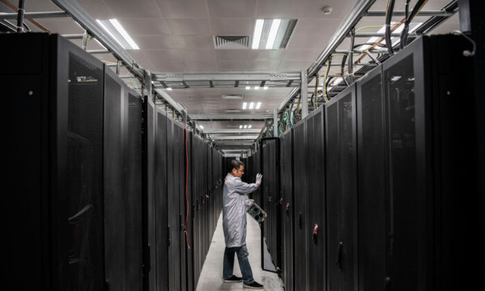 A Huawei engineer opens the door a server unit to display during an organized tour at the Cyber Security Lab of the company's production campus in Dongguan, near Shenzhen, China, on April 25, 2019. (Kevin Frayer/Getty Images)
