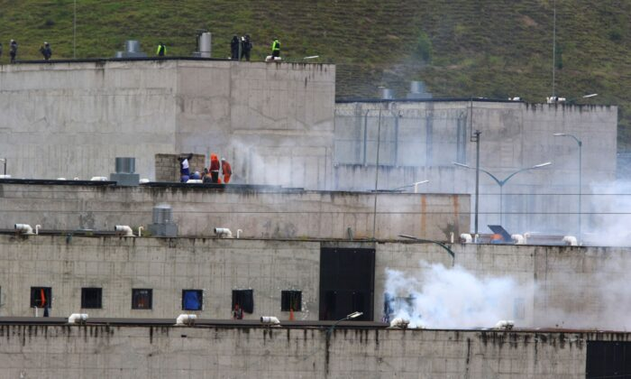 Tear gas rises from parts of Turi jail where an inmate riot broke out in Cuenca, Ecuador, on Feb. 23, 2021. (Marcelo Suquilanda/AP Photo)