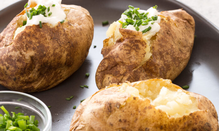 Painting the potatoes with vegetable oil once they're cooked through results in a crispy skin. (Daniel J. van Ackere/TNS)