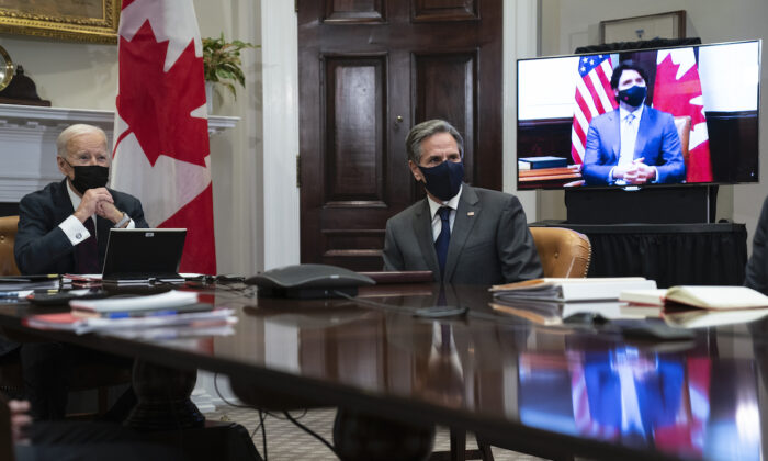 President Joe Biden and Secretary of State Antony Blinken listen as Canadian Prime Minister Justin Trudeau speaks during a virtual bilateral meeting, in the Roosevelt Room of the White House, in Washington on Feb. 23, 2021. (Evan Vucci/AP Photo)