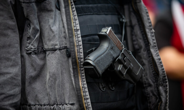 A man openly carries a handgun during a rally in Portland, Ore., on Sept. 26, 2020. (Maranie R. Staab/AFP via Getty Images)