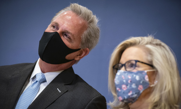 House Minority Leader Kevin McCarthy (R-Calif.) whispers to Rep. Liz Cheney (R-Wyo.) during a House Republican Leadership news conference in the U.S. Capitol in Washington on Feb. 24, 2021. (Al Drago/Getty Images)