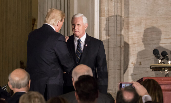 President Donald Trump and Vice President Mike Pence speak during a Congressional Gold Medal ceremony honoring former Sen. Bob Dole at the U.S. Capitol in Washington, on Jan. 17, 2018. (Samira Bouaou/The Epoch Times)