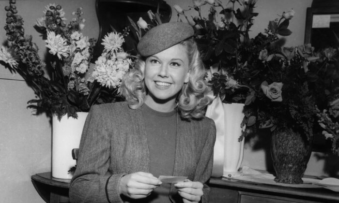 "American actress and singer Doris Day in her dressing room on the set of ""Romance on the High Seas."" (Hulton Archive/Getty Images)"
