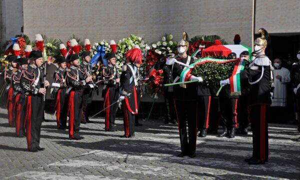 Carabinieri paramilitary police carry the caskets