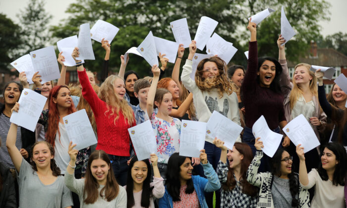 Pupils react as they open their GCSE exam results at Withington Girls' School, Manchester, England, on Aug. 25, 2016. (Christopher Furlong/Getty Images)
