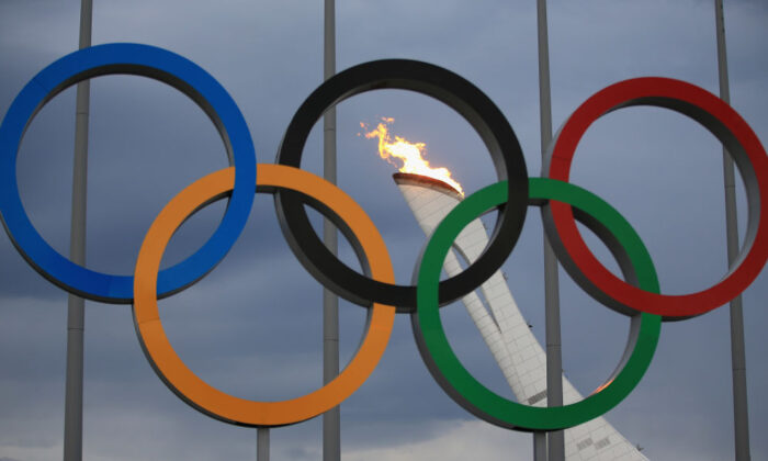 The Olympic Cauldron is tested by fire crews at the Sochi 2014 Winter Olympic Park in the Costal Cluster on January 27, 2014 in Sochi, Russia.  (Richard Heathcote/Getty Images)