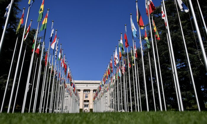 """The """"Palais des Nations"""", which houses the U.N. Offices, is seen at the end of the flag-lined front lawn in Geneva, Switzerland, on Sept. 4, 2018. (Fabrice Coffrini/AFP via Getty Images)"""
