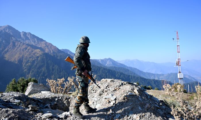 An Indian Army soldier stands guard near Nastachun pass, also known as Sadhana pass, about 5 miles from the Line of Control (LOC) in the district of Kupwara, on Oct. 14, 2020. (Money Sharma/AFP via Getty Images)