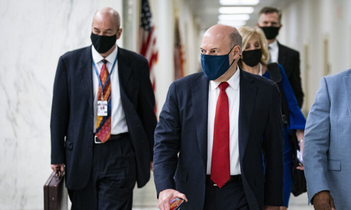 U.S. Postal Service Postmaster General Louis DeJoy departs following a hearing in Washington on Feb. 24, 2021. (Al Drago/Getty Images)