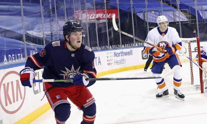 New York Rangers' Alexis Lafreniere skates against the New York Islanders during an NHL hockey game on Feb. 8, 2021, in New York. (Bruce Bennett/Pool Photo via AP)