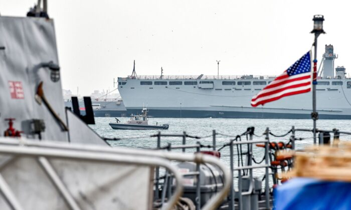 A U.S. Navy patrol ship guards U.S. and coalitions ships docked at the US 5th Fleet Command in Manama, Bahrain, on Dec. 17, 2019. (Mazen Mahdi/AFP via Getty Images)