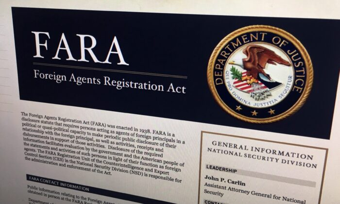 A portion of the website for the U.S.'s Foreign Agents Registration Act in Washington in a file photo. (AP Photo/Jon Elswick, File)