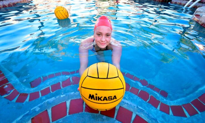"High school water polo player Cami Rowan works out in a home pool in Corona, Calif. on Feb. 18, 2021. It's been almost a year since the ""Golden State"" banned its high school students from sports competitions, affecting 3 million school children. (Frederic J.  Brown/AFP via Getty Images)"