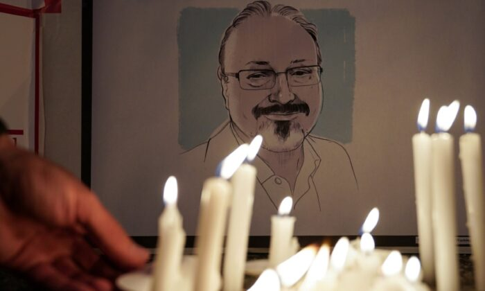 The Committee to Protect Journalists and other press freedom activists hold a candlelight vigil in front of the Saudi Embassy to mark the anniversary of the killing of journalist Jamal Khashoggi at the kingdom's consulate in Istanbul, Turkey, on Oct. 2, 2019. (Sarah Silbiger/Reuters)