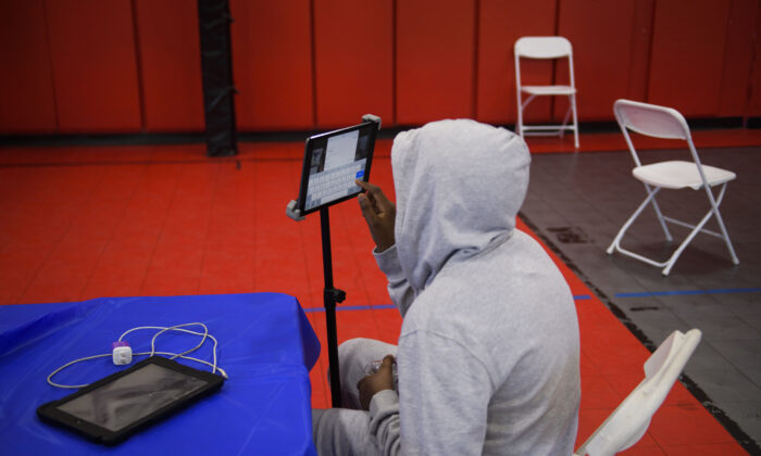 A child attends an online class in a YMCA in Los Angeles, Calif., on Feb. 17, 2021. (Patrick T. Fallon/AFP via Getty Images)