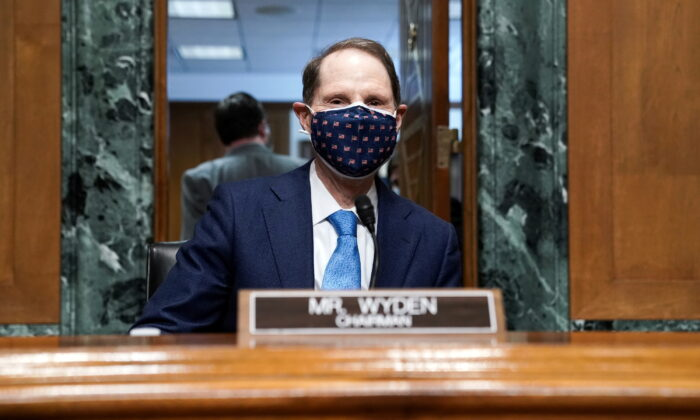 Sen. Ron Wyden (D-Ore.) attends a Senate Finance Committee hearing in Washington on Feb. 23, 2021. (Greg Nash/Pool via Reuters)