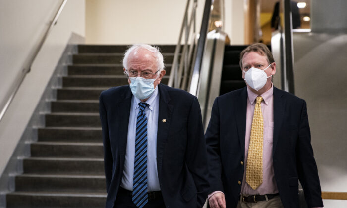 Sen. Bernie Sanders (I-Vt.) departs following a vote in the subway of the U.S. Capitol in Washington on Feb. 23, 2021. (Al Drago/Getty Images)