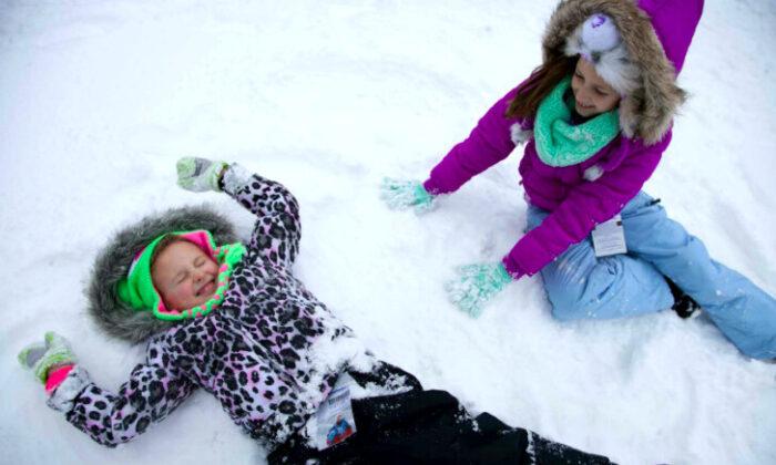 Making snow angels in Gatlinburg, Tenn. (Courtesy of Gatlinburg Convention and Visitors Bureau)