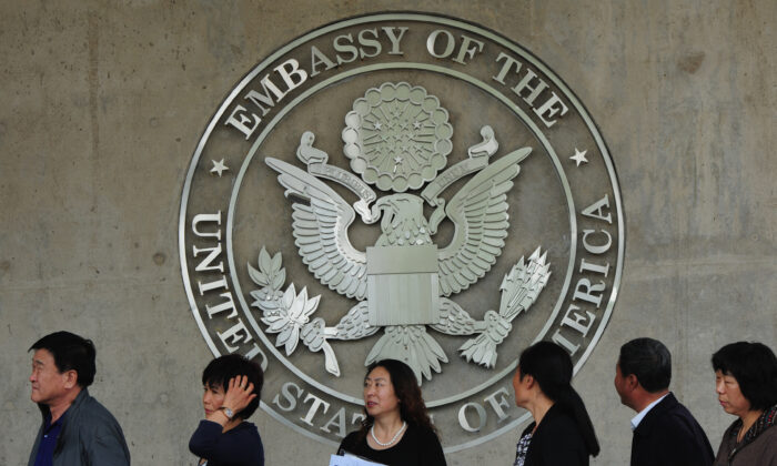 Chinese citizens wait to submit their visa applications at the US Embassy in Beijing on May 2, 2012. (Mark Ralston/AFP/GettyImages)