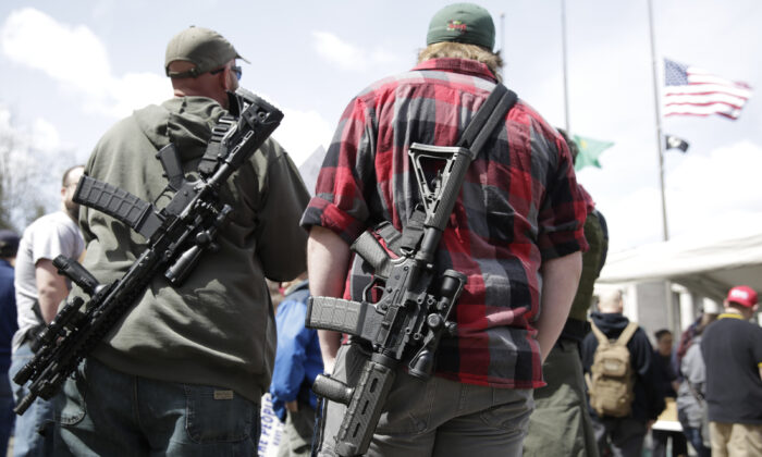 People with firearms stand in Olympia, Wash., on April 21, 2018. (Jason Redmond/AFP via Getty Images)