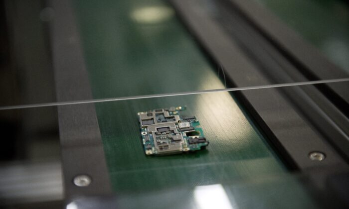 A smartphone chip component circuit is seen at the Oppo factory in Dongguan on May 8, 2017.  (Nicolas Asfouri/AFP via Getty Images)