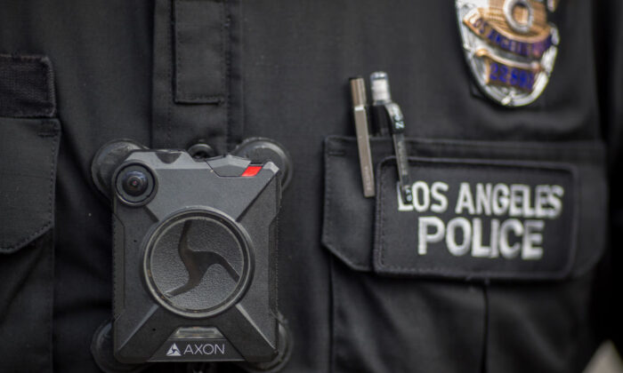 A Los Angeles police officer wears an Axon body camera during a Feb. 18, 2017, protest in Los Angeles, Calif. (Photo by David McNew/Getty Images)
