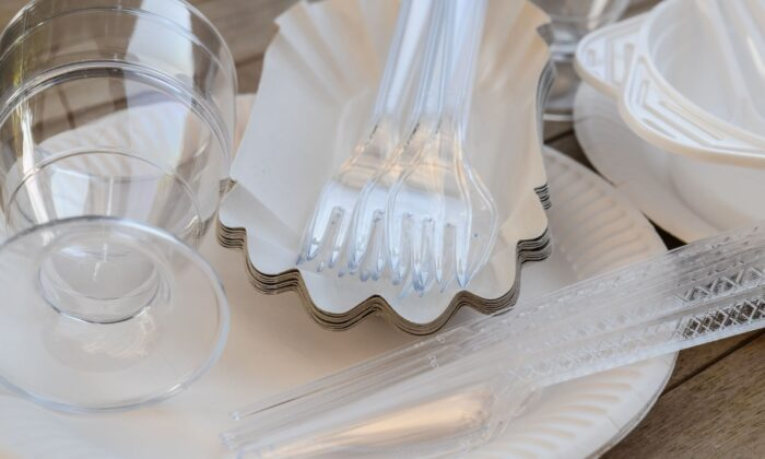 A picture taken in Sieversdorf, eastern Germany shows plastic cutlery on a table. on May 24, 2018. (Patrick Pleul/DPA/AFP via Getty Images)