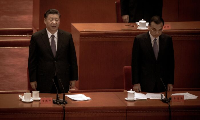 Chinese leader Xi Jinping (L) and Premier Li Keqiang sing the national anthem at a ceremony marking the 70th anniversary of China's entry into the Korean War, at the Great Hall of the People in Beijing, China on Oct. 23, 2020.  (Kevin Frayer/Getty Images)