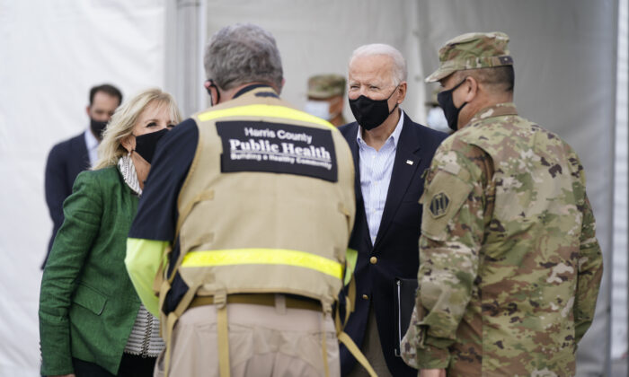 President Joe Biden and First Lady Jill Biden arrive at a FEMA COVID-19 mass vaccination site at NRG Stadium in Houston, Texas, on Feb. 26, 2021. (Patrick Semansky/AP Photo)