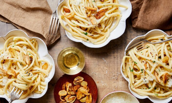 This ultimate garlic pasta uses garlic two ways: roasted until caramelized and jammy for a luscious sauce, and sliced and fried for a crispy topping. (Kristin Teig/TNS)