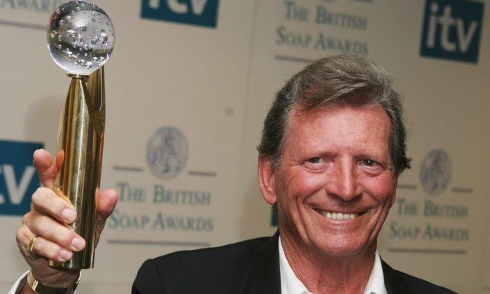 """Actor, Johnny Briggs with his award given for """"Lifetime Achievement"""", in the Pressroom at the British Soap Awards 2006 at BBC Television Centre in London, England, on May 20, 2006. (Ben Stansall/Getty Images)"""