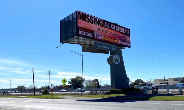 An electronic billboard calls for the reopening of schools, next to Highway 101 in Rohnert Park, Calif., on Feb. 25, 2021. (Ted Lin/The Epoch Times)