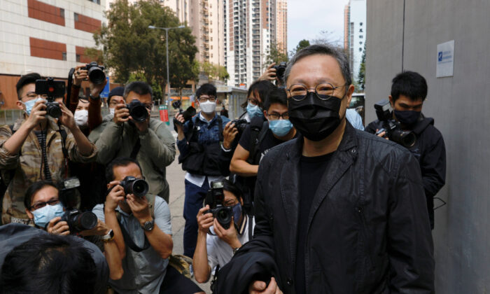 Pro-democracy activist Benny Tai is greeted by media members as he arrives to report to the police station over national security law charges in Hong Kong on Feb. 28, 2021. (Tyrone Siu/Reuters)