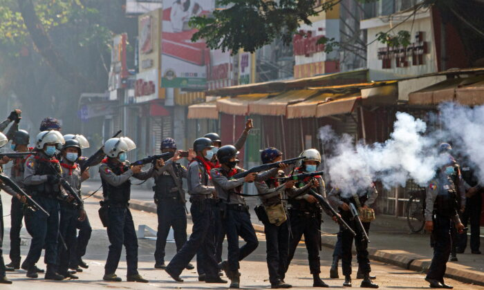 Riot police officers fire teargas canisters during a protest against the military coup in Yangon, Burma, on Feb. 28, 2021. (Stringer via Reuters)