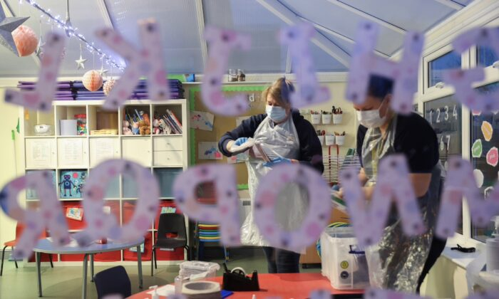 Nursery staff members at Little Stars Childcare take part in the Staffordshire County Council's pilot testing initiative to allow nurseries to test staff weekly, amidst the spread of the coronavirus disease (COVID-19), in Newcastle-under-Lyme, Staffordshire, Britain, on Feb. 15, 2021. (Carl Recine/Reuters)