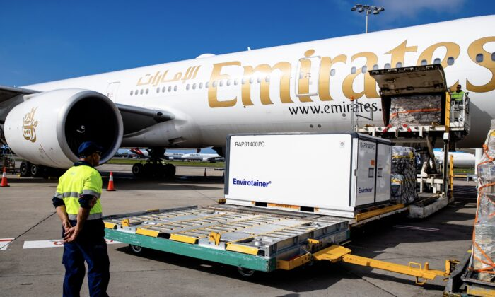 Container holding the AstraZeneca COVID-19 vaccine is removed from the Emirates airlines plane as the first vaccination doses into the country arrives at Sydney International airport in Australia on Feb. 28, 2021. (Edwina Pickles - Pool/Getty Images)