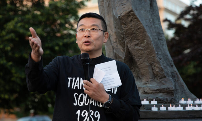 Human rights activist Yang Jianli speaks at a candlelight vigil to commemorate the 29th Anniversary of the June 4th Tiananmen Square Massacre at the Victims of Communism Memorial in Washington on June 4, 2018. (Samira Bouaou/The Epoch Times)