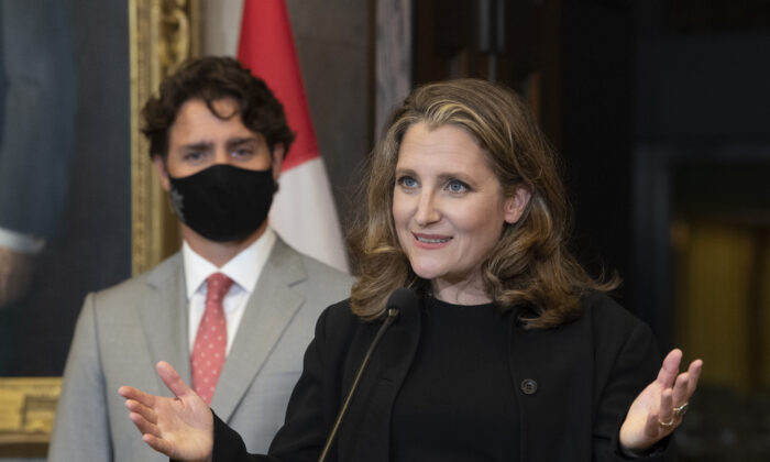 Prime Minister Justin Trudeau looks on as Deputy Prime Minister and Finance Minister Chrystia Freeland responds to a question during a news conference on Parliament Hill in Ottawa, Canada, on Aug. 18, 2020. (Adrian Wyld/The Canadian Press)