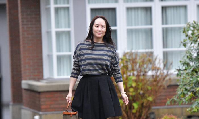 Huawei Chief Financial Officer, Meng Wanzhou, leaves her Vancouver home to attend British Columbia Supreme Court, in Vancouver, British Columbia on Dec. 8, 2020. (DON MACKINNON/AFP via Getty Images)