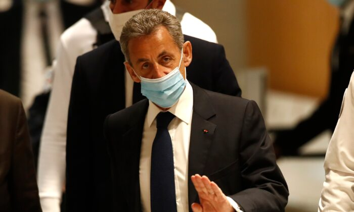 Former French President Nicolas Sarkozy arrives at the courtroom in Paris, on March 1, 2021. (Michel Euler /AP Photo)