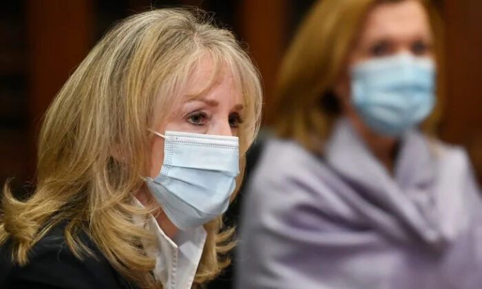 Merrilee Fullerton, Ontario's Minister of Long-Term Care listens to updates regarding the Ontario COVID-19 vaccine during the COVID-19 pandemic in Toronto on January 5, 2021. (Nathan Denette/The Canadian Press)