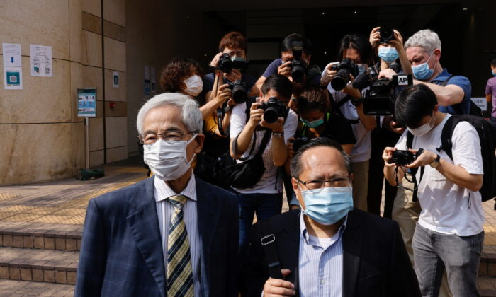Democratic Party founder and barrister Martin Lee and Albert Ho arrive at the West Kowloon Courts for verdicts in the city's landmark unlawful assembly case, in Hong Kong on April 1, 2021. (Tyrone Siu/Reuters)