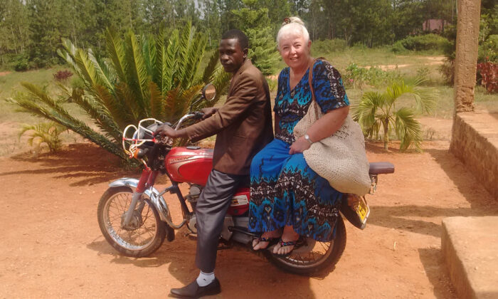 Margaret Nelson on a boda-boda motorbike taxi near Kampala, Uganda, 2018. (Margaret Nelson)