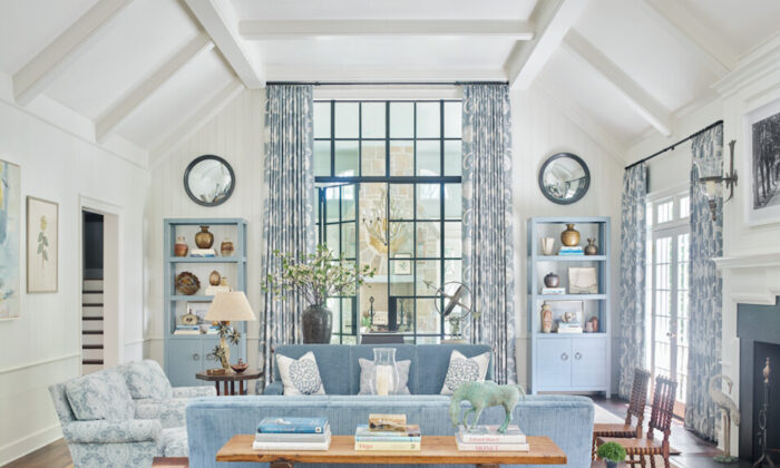 For the family room of a house in the Buckhead district of Atlanta, interior designer Phoebe Howard used étagères (open shelves) to balance the scale of the large-sized doors. (Emily Followill)
