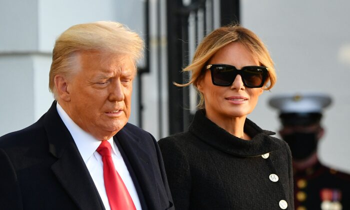 Then-President Donald Trump and First Lady Melania Trump make their way to board Marine One as they depart the White House in Washington on Jan. 20, 2021. (Mandel Ngan/AFP via Getty Images)